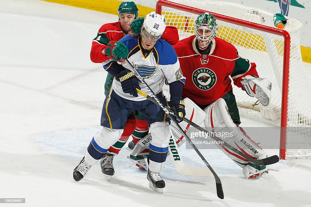 <a gi-track='captionPersonalityLinkClicked' href=/galleries/search?phrase=Alexander+Steen&family=editorial&specificpeople=600136 ng-click='$event.stopPropagation()'>Alexander Steen</a> #20 of the St. Louis Blues battles for position with <a gi-track='captionPersonalityLinkClicked' href=/galleries/search?phrase=Clayton+Stoner&family=editorial&specificpeople=2222214 ng-click='$event.stopPropagation()'>Clayton Stoner</a> #4 and goalie Niklas Backstrom #32 of the Minnesota Wild during the game on April 11, 2013 at the Xcel Energy Center in Saint Paul, Minnesota.