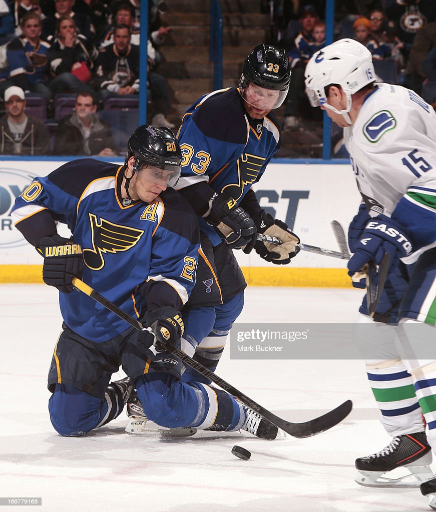 <a gi-track='captionPersonalityLinkClicked' href=/galleries/search?phrase=Alexander+Steen&family=editorial&specificpeople=600136 ng-click='$event.stopPropagation()'>Alexander Steen</a> #20 of the St. Louis Blues battles for the puck with <a gi-track='captionPersonalityLinkClicked' href=/galleries/search?phrase=Derek+Roy&family=editorial&specificpeople=203272 ng-click='$event.stopPropagation()'>Derek Roy</a> #15 of the Vancouver Canucks in an NHL game on April 16, 2013 at Scottrade Center in St. Louis, Missouri.