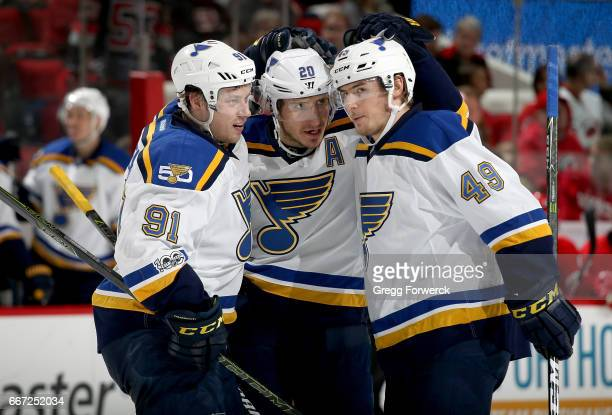 Alexander Steen of the St Louis Blues celebrates scoring a goal with teammates Ivan Barbashev and Vladimir Tarasenko during an NHL game against the...