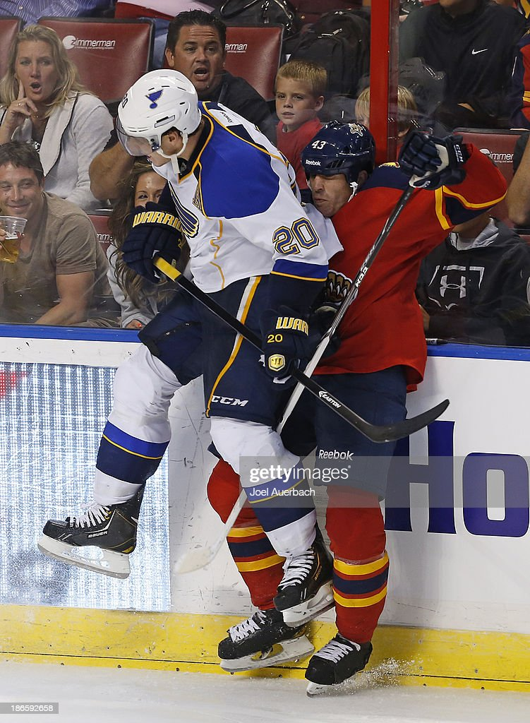 <a gi-track='captionPersonalityLinkClicked' href=/galleries/search?phrase=Alexander+Steen&family=editorial&specificpeople=600136 ng-click='$event.stopPropagation()'>Alexander Steen</a> #20 of the St. Louis Blues checks Mike Weaver #43 of the Florida Panthers at the BB&T Center on November 1, 2013 in Sunrise, Florida. The Blues defeated the Panthers 4-0.