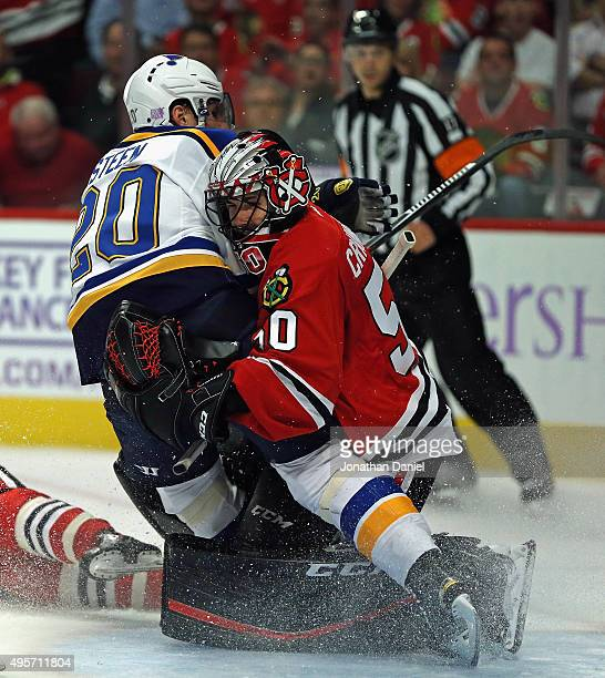 Alexander Steen of the St Louis Blues collides with Corey Crawford of the Chicago Blackhawks at the United Center on November 4 2015 in Chicago...