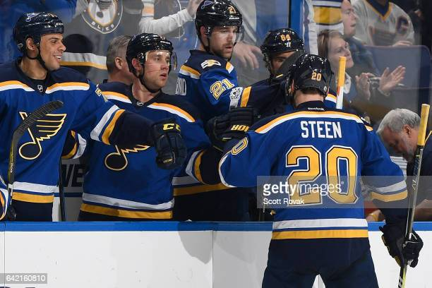 Alexander Steen of the St Louis Blues is congratulated by Ryan Reaves Jaden Schwartz and Patrik Berglund after scoring against the Vancouver Canucks...