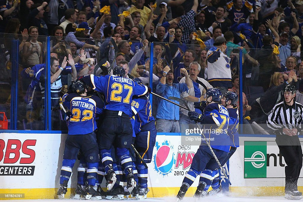 Alexander Steen #20 of the St. Louis Blues is mobbed by his teammates after scoring the game-winning goal in overtime against the Los Angeles Kings in Game One of the Western Conference Quarterfinals during the 2013 NHL Stanley Cup Playoffs at the Scottrade Center on April 30, 2013 in St. Louis, Missouri. The Blues beat the Kings 2-1 in overtime.