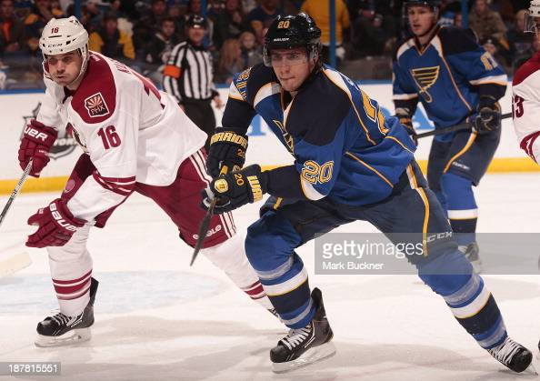 Alexander Steen of the St Louis Blues races Rostislav Klesla of the Phoenix Coyotes down ice on November 12 2013 at Scottrade Center in St Louis...