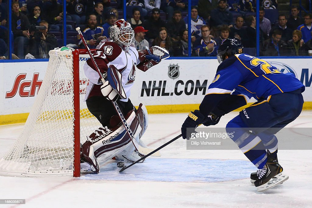 <a gi-track='captionPersonalityLinkClicked' href=/galleries/search?phrase=Alexander+Steen&family=editorial&specificpeople=600136 ng-click='$event.stopPropagation()'>Alexander Steen</a> #20 of the St. Louis Blues scores a goal against <a gi-track='captionPersonalityLinkClicked' href=/galleries/search?phrase=Jean-Sebastien+Giguere&family=editorial&specificpeople=202814 ng-click='$event.stopPropagation()'>Jean-Sebastien Giguere</a> #35 of the Colorado Avalanche at the Scottrade Center on November 14, 2013 in St. Louis, Missouri. The Blues beat the Avalanche 7-3.