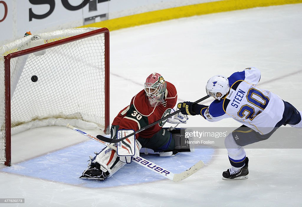 <a gi-track='captionPersonalityLinkClicked' href=/galleries/search?phrase=Alexander+Steen&family=editorial&specificpeople=600136 ng-click='$event.stopPropagation()'>Alexander Steen</a> #20 of the St. Louis Blues scores a goal against <a gi-track='captionPersonalityLinkClicked' href=/galleries/search?phrase=Ilya+Bryzgalov&family=editorial&specificpeople=2285430 ng-click='$event.stopPropagation()'>Ilya Bryzgalov</a> #30 of the Minnesota Wild during the shootout of the game on March 9, 2014 at Xcel Energy Center in St Paul, Minnesota. The Blues defeated the Wild 3-2 in a shootout.