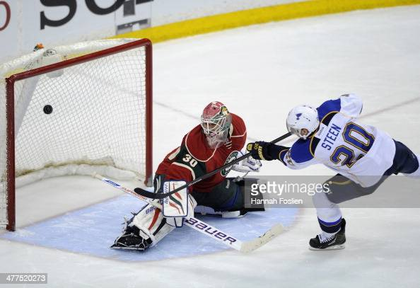 Alexander Steen of the St Louis Blues scores a goal against Ilya Bryzgalov of the Minnesota Wild during the shootout of the game on March 9 2014 at...