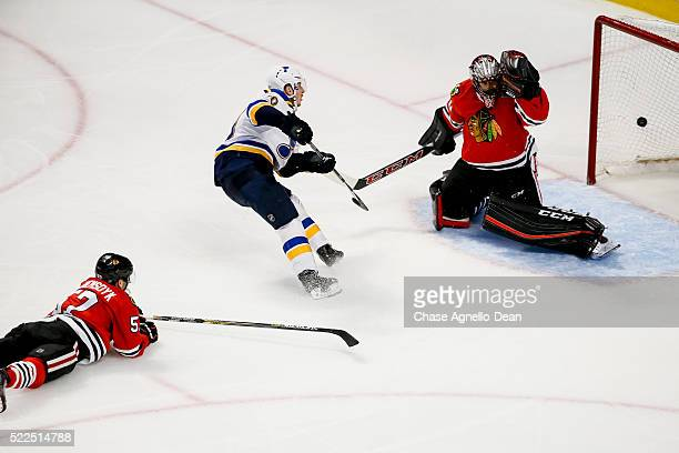 Alexander Steen of the St Louis Blues scores on goalie Corey Crawford of the Chicago Blackhawks in the third period of Game Four of the Western...