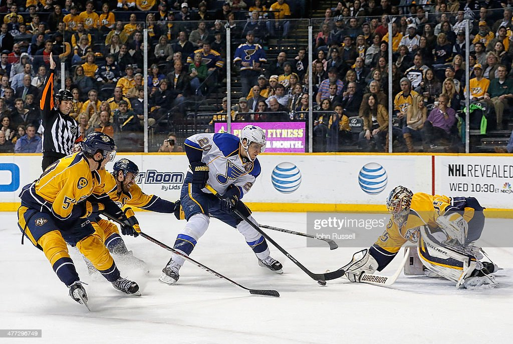 <a gi-track='captionPersonalityLinkClicked' href=/galleries/search?phrase=Alexander+Steen&family=editorial&specificpeople=600136 ng-click='$event.stopPropagation()'>Alexander Steen</a> #20 of the St. Louis Blues shoots the puck against goalie <a gi-track='captionPersonalityLinkClicked' href=/galleries/search?phrase=Pekka+Rinne&family=editorial&specificpeople=2118342 ng-click='$event.stopPropagation()'>Pekka Rinne</a> #35 as <a gi-track='captionPersonalityLinkClicked' href=/galleries/search?phrase=Shea+Weber&family=editorial&specificpeople=554412 ng-click='$event.stopPropagation()'>Shea Weber</a> #6 and <a gi-track='captionPersonalityLinkClicked' href=/galleries/search?phrase=Roman+Josi&family=editorial&specificpeople=4247871 ng-click='$event.stopPropagation()'>Roman Josi</a> #59 of the Nashville Predators defend at Bridgestone Arena on March 6, 2014 in Nashville, Tennessee.