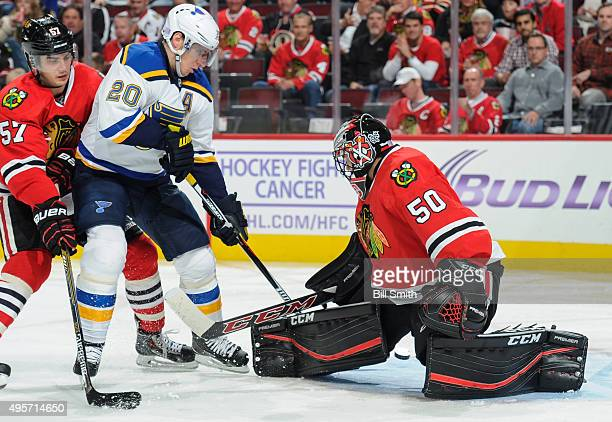 Alexander Steen of the St Louis Blues shoots the puck against goalie Corey Crawford of the Chicago Blackhawks to score as Trevor van Riemsdyk follows...