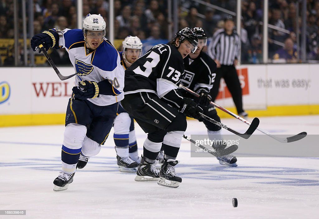 <a gi-track='captionPersonalityLinkClicked' href=/galleries/search?phrase=Alexander+Steen&family=editorial&specificpeople=600136 ng-click='$event.stopPropagation()'>Alexander Steen</a> #20 of the St. Louis Blues skates around <a gi-track='captionPersonalityLinkClicked' href=/galleries/search?phrase=Tyler+Toffoli&family=editorial&specificpeople=6514151 ng-click='$event.stopPropagation()'>Tyler Toffoli</a> #73 of the Los Angeles Kings for the puck in the third period of Game Six of the Western Conference Quarterfinals during the 2013 NHL Stanley Cup Playoffs at Staples Center on May 10, 2013 in Los Angeles, California. The Kings defeated the Blues 2-1.