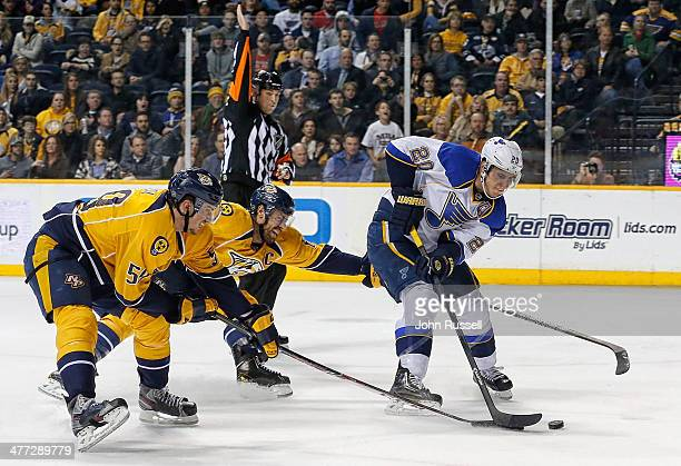 Alexander Steen of the St Louis Blues skates in on net with the puck against Shea Weber and Roman Josi of the Nashville Predators at Bridgestone...