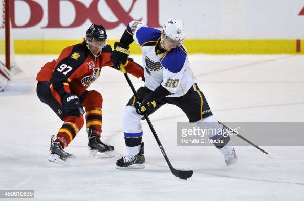 Alexander Steen of the St Louis Blues skates with the puck as Matt Gilroy chases during a NHL game at the BBT Center on November 1 2013 in Sunrise...