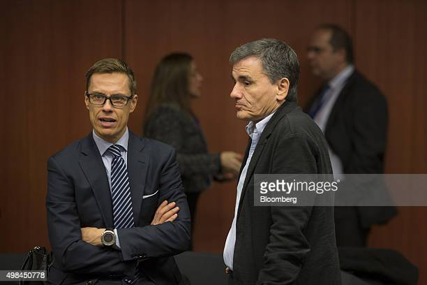 Alexander Stubb Finland's finance minister left speaks with Euclid Tsakalotos Greece's finance minister ahead of 2016 draft budget roundtable talks...