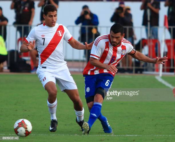 Alexander Succar of Perus national football team vies for the ball with Paraguays Miguel Samudio during their friendly match on June 8 2017 at the...
