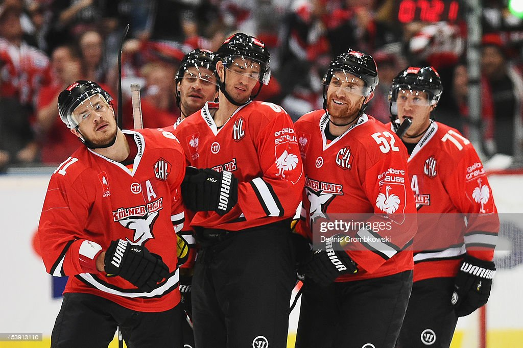 <a gi-track='captionPersonalityLinkClicked' href=/galleries/search?phrase=Alexander+Sulzer&family=editorial&specificpeople=673531 ng-click='$event.stopPropagation()'>Alexander Sulzer</a> of Koelner Haie celebrates with team mates after scoring his team's first goal during the Champions Hockey League group stage game between Koelner Haie and HC Kosice on August 21, 2014 in Cologne, Germany.