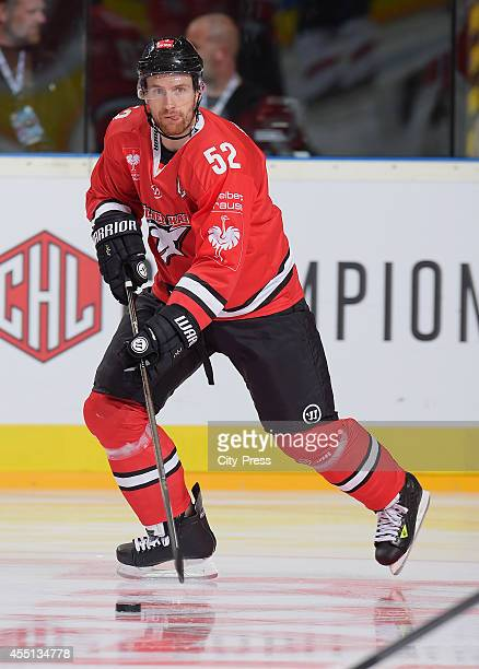 Alexander Sulzer of Koelner Haie handles the puck during the action shot on august 21 2014 in Koeln Germany