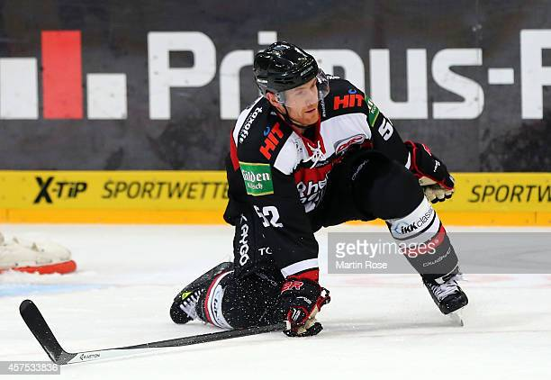 Alexander Sulzer of Koelner Haie skates against the Eisbaeren Berlin battle for the puck during the DEL Ice Hockey match between Koelner Haie and...
