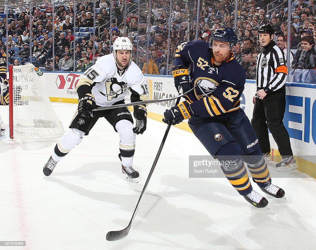 <a gi-track='captionPersonalityLinkClicked' href=/galleries/search?phrase=Alexander+Sulzer&family=editorial&specificpeople=673531 ng-click='$event.stopPropagation()'>Alexander Sulzer</a> #52 of the Buffalo Sabres passes the puck away as <a gi-track='captionPersonalityLinkClicked' href=/galleries/search?phrase=Tanner+Glass&family=editorial&specificpeople=4596666 ng-click='$event.stopPropagation()'>Tanner Glass</a> #15 of the Pittsburgh Penguins reaches in from behind at First Niagara Center on February 5, 2014 in Buffalo, New York. Pittsburgh defeated Buffalo 5-1.