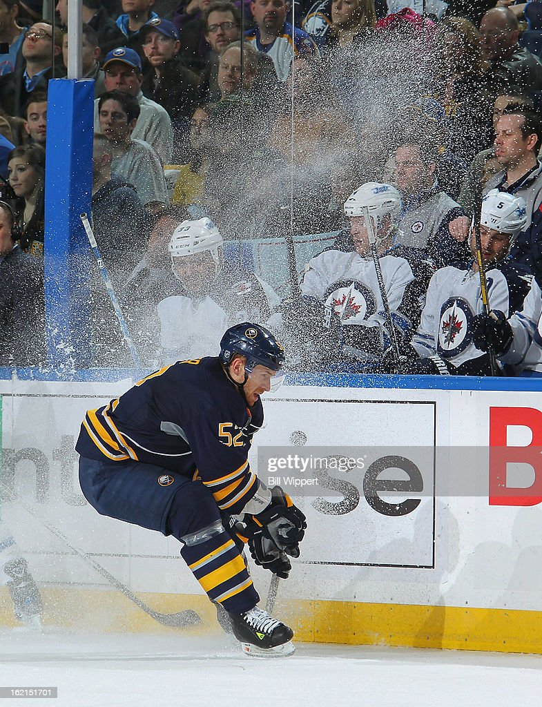 Alexander Sulzer #52 of the Buffalo Sabres sends snow flying as he makes a quick stop in front of the bench of the Winnipeg Jets on February 19, 2013 at the First Niagara Center in Buffalo, New York.