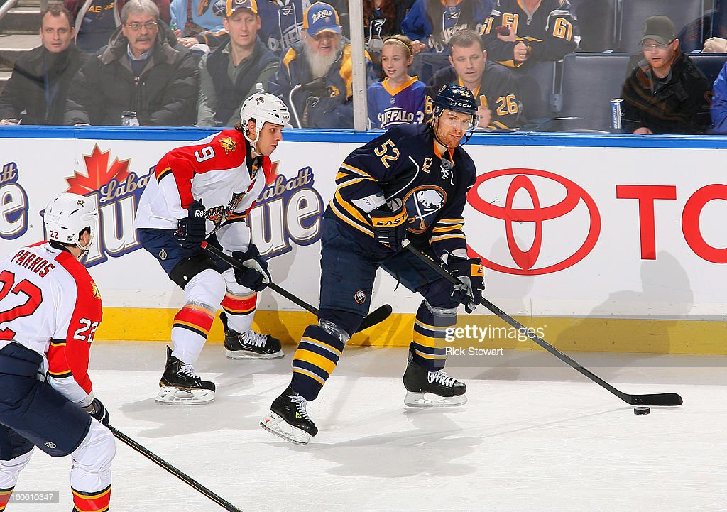 Alexander Sulzer #52 of the Buffalo Sabres skates against Stephen Weiss #9 of the Florida Panthers at First Niagara Center on February 3, 2013 in Buffalo, New York.