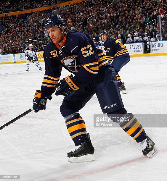 Alexander Sulzer of the Buffalo Sabres skates against the Winnipeg Jets on December 17 2013 at the First Niagara Center in Buffalo New York