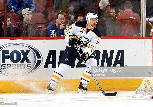Alexander Sulzer of the Buffalo Sabres skates with the puck against the Phoenix Coyotes at Jobingcom Arena on January 30 2014 in Glendale Arizona