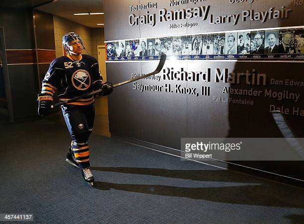 Alexander Sulzer of the Buffalo Sabres walks to the ice to warm up for their game against the Winnipeg Jets on December 17 2013 at the First Niagara...