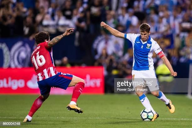 Alexander Szymanowski of CD Leganes fights for the ball with Sime Vrsaljko of Atletico de Madrid during the La Liga 201718 match between CD Leganes...