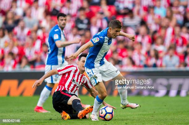 Alexander Szymanowski of Club Deportivo Leganes competes for the ball with Aritz Aduriz of Athletic Club during the La Liga match between Athletic...