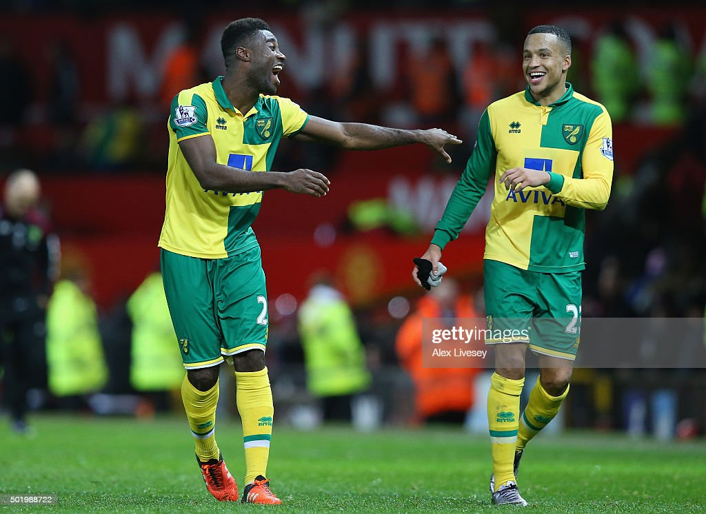 Alexander Tettey and <a gi-track='captionPersonalityLinkClicked' href=/galleries/search?phrase=Martin+Olsson&family=editorial&specificpeople=4185617 ng-click='$event.stopPropagation()'>Martin Olsson</a> of Norwich City celebrate their team's 2-1 win in the Barclays Premier League match between Manchester United and Norwich City at Old Trafford on December 19, 2015 in Manchester, England.
