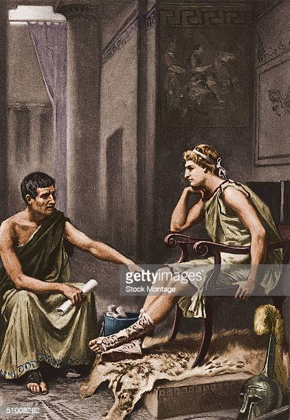Alexander the Great later King of Macedon and conqueror of a vast empire stretching from the Balkans to India listens studiously to his tutor the...