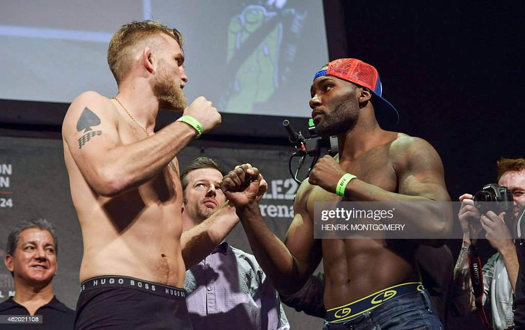 Alexander 'The Mauler' Gustafsson of Sweden and US Anthony 'Rumble' Johnson pose for photos following the weighin for Saturday's UFC light...