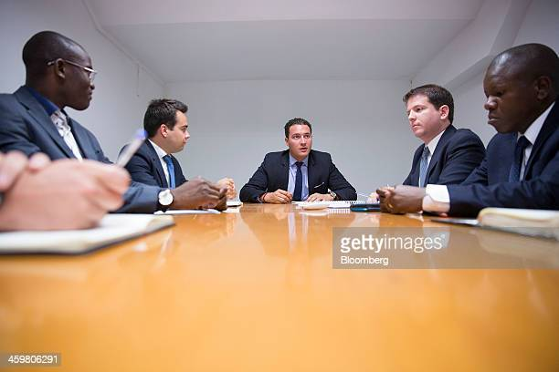 Alexander ThomsonPayan chief executive officer of Thomson Group International Ltd center speaks to members of his management team in the boardroom of...
