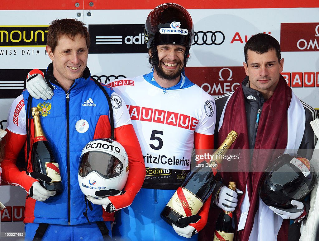 Alexander Tretjyakov of Russia celebrates with second placed Martins Dukurs of Latvia and third placed Sergei Chudinov of Russia after winning the man's skeleton final heat of the IBSF Bob & Skeleton World Championship at Olympia Bob Run on February 2, 2013 in St Moritz, Switzerland.