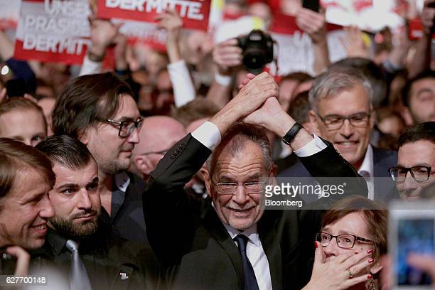 Alexander Van der Bellen presidential candidate of Austria's Green Party gestures while arriving for an election party in Vienna Austria on Sunday...