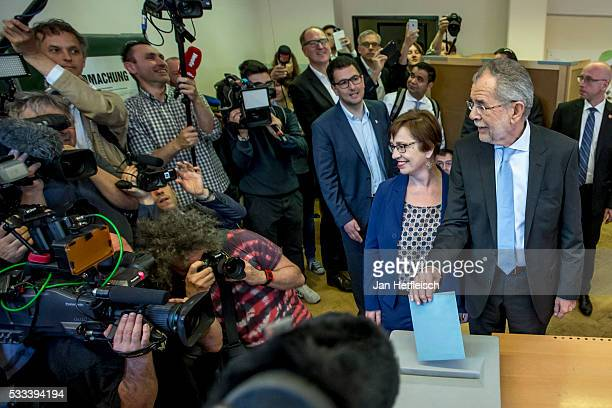 Alexander Van der Bellen presidential candidate of the Green Party casts his ballot at a polling station during the Austrian presidential election on...