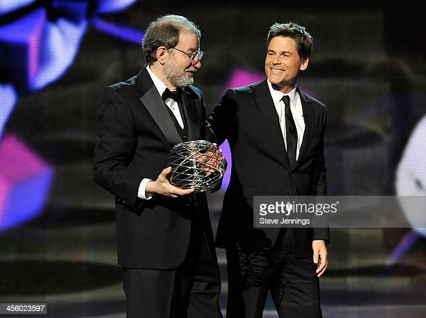 Alexander Varshavsky is awarded by presenter Rob Lowe at the 2014 Breakthrough Prizes Awarded in Fundamental Physics and Life Sciences Ceremony at...