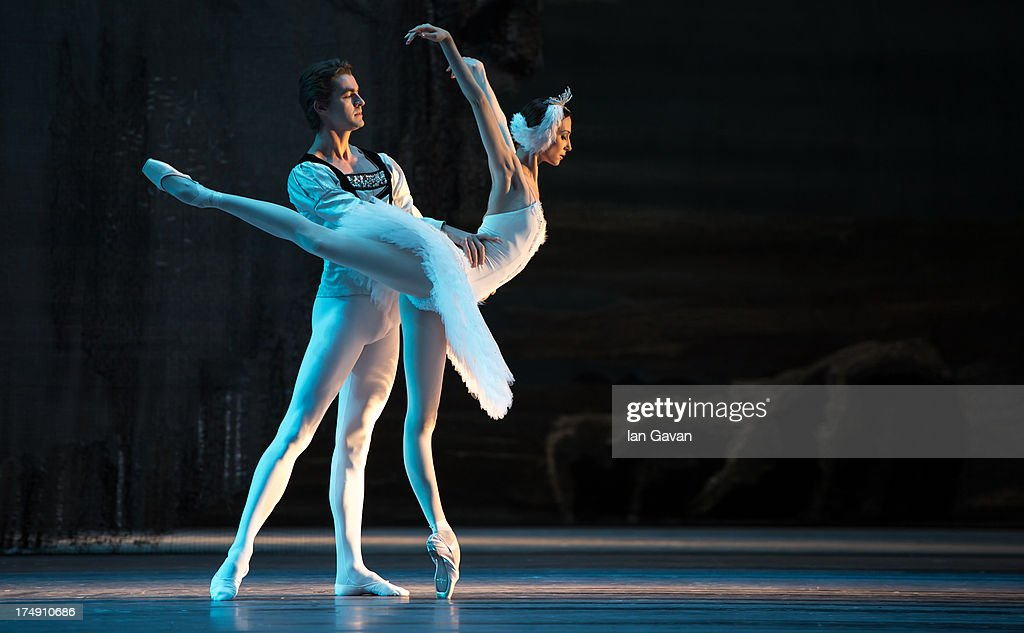 Alexander Volchkov and Svetlana Zakharova of the Bolshoi Ballet perform during a photocall for 'Swan Lake' at The Royal Opera House on July 29, 2013 in London, England.