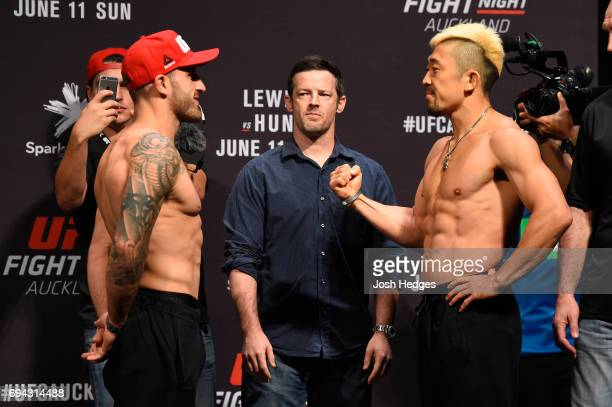 Alexander Volkanovski of Australia and Mizuto Hirota of Japan face off during the UFC Fight Night weighin at Spark Arena on June 10 2017 in Auckland...