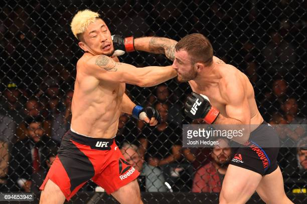 Alexander Volkanovski of Australia punches Mizuto Hirota of Japan in their featherweight fight during the UFC Fight Night event at the Spark Arena on...