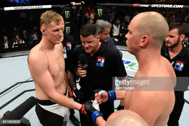 Alexander Volkov of Russia and Stefan Struve of The Netherlands touch gloves before their heavyweight bout during the UFC Fight Night event at the...