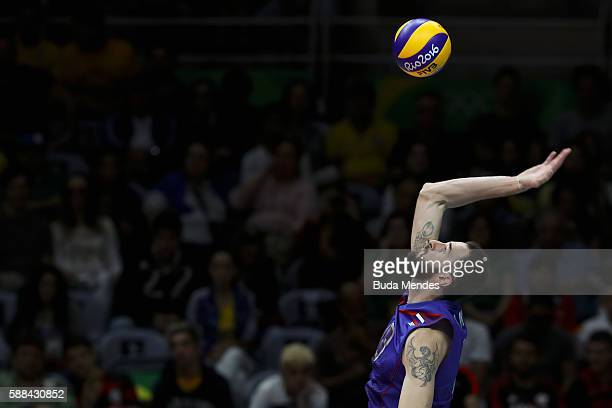 Alexander Volkov of Russia hits the ball during the men's qualifying volleyball match between Russia and Egypt on Day 6 of the Rio 2016 Olympic Games...