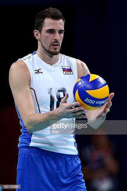 Alexander Volkov of Russia looks to serve against Bulgaria during the Men's Volleyball Semifinals on Day 14 of the London 2012 Olympic Games at Earls...