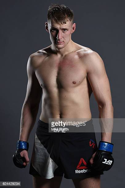 Alexander Volkov of Russia poses for a portrait backstage after his victory over Timothy Johnson during the UFC Fight Night at the SSE Arena on...