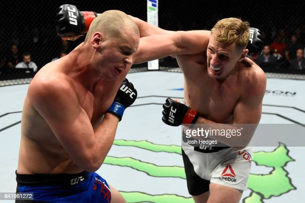 Alexander Volkov of Russia punches Stefan Struve of The Netherlands in their heavyweight bout during the UFC Fight Night event at the Rotterdam Ahoy...