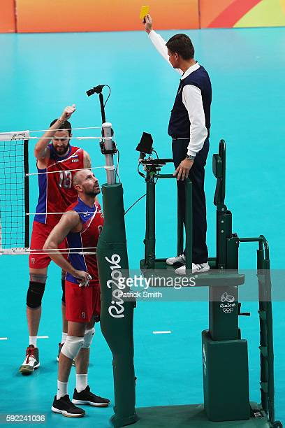 Alexander Volkov of Russia receives a yellow card during the Men's Volleyball Semifinal match on Day 14 of the Rio 2016 Olympic Games at the...