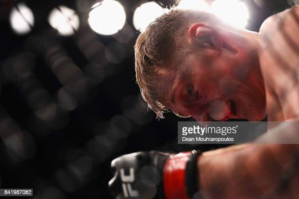 Alexander Volkov of Russia recovers from a poked eye from Stefan Struve of the Netherlands as they compete in their Heavyweight bout during the UFC...