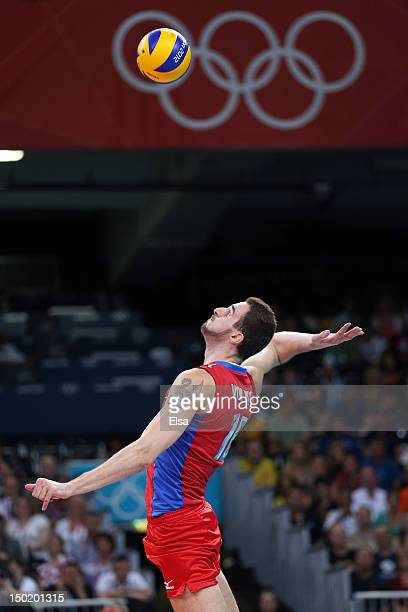 Alexander Volkov of Russia serves against Brazil during the Men's Volleyball gold medal match on Day 16 of the London 2012 Olympic Games at Earls...