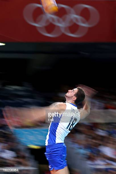 Alexander Volkov of Russia serves the ball against Bulgaria during the Men's Volleyball Semifinals on Day 14 of the London 2012 Olympic Games at...